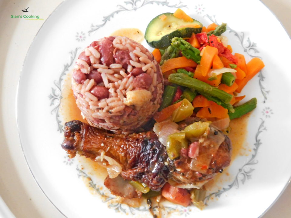 Rice and peas with brown stew chicken and steamed vegetables