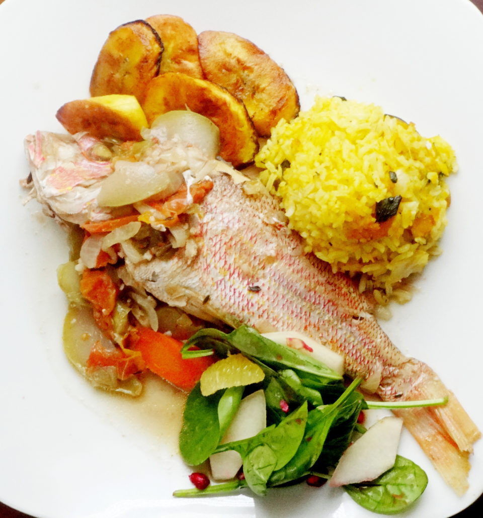 steamed fish with pumpkin rice and fried plantain